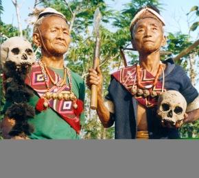 Konyak Headhunters of yore staging a headhunting incident, Longmein Village, Nagaland, 2001