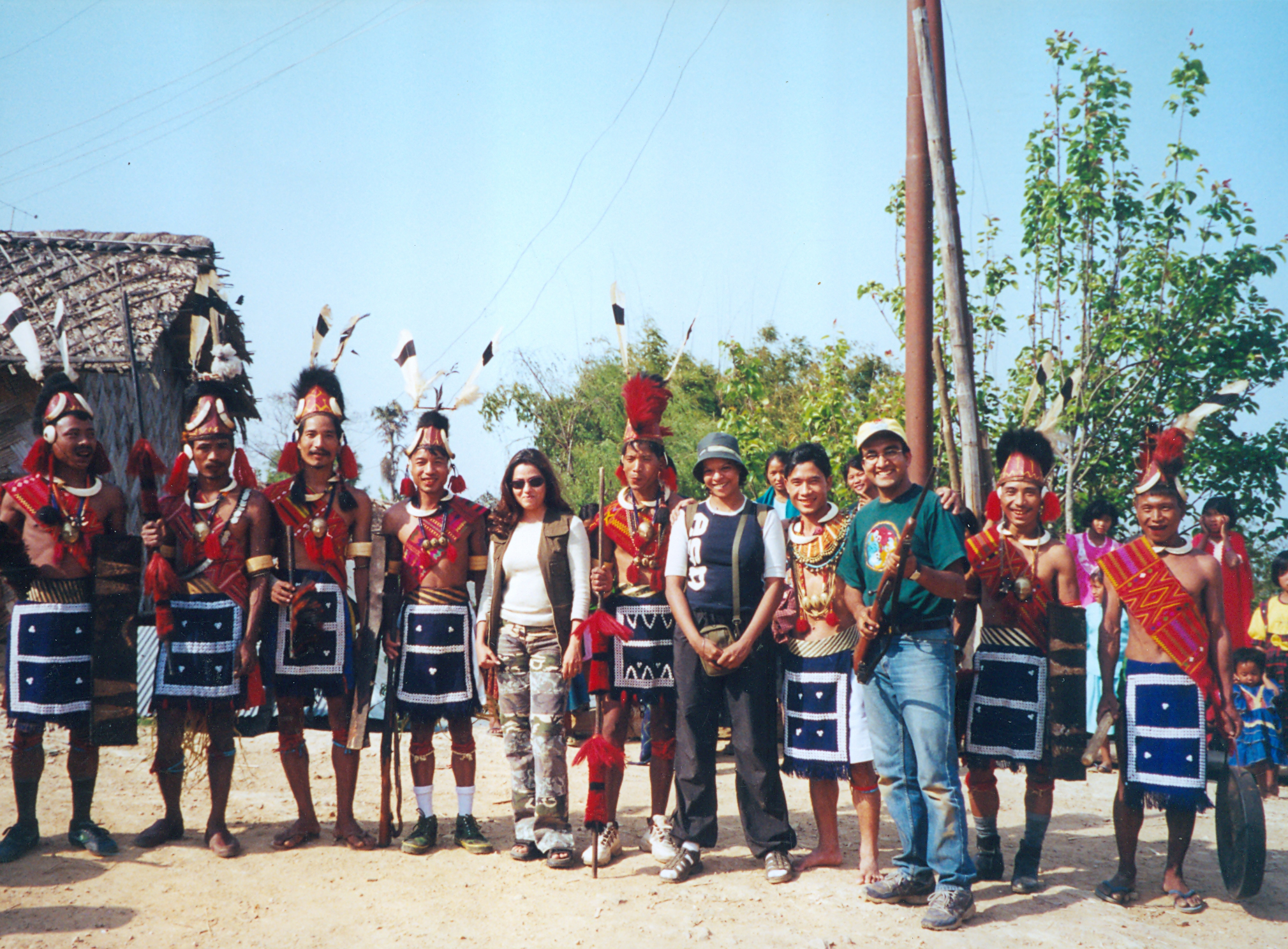 Anu Malhotra and Crew with Konyak Men, Wanching Village, Nagaland, 2001